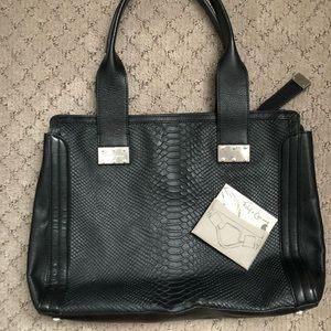 Black leather tote with embossed snake texture